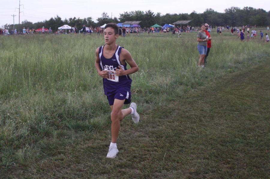 Cross Country member, Nolen Geitz, running hard at a recent track meet