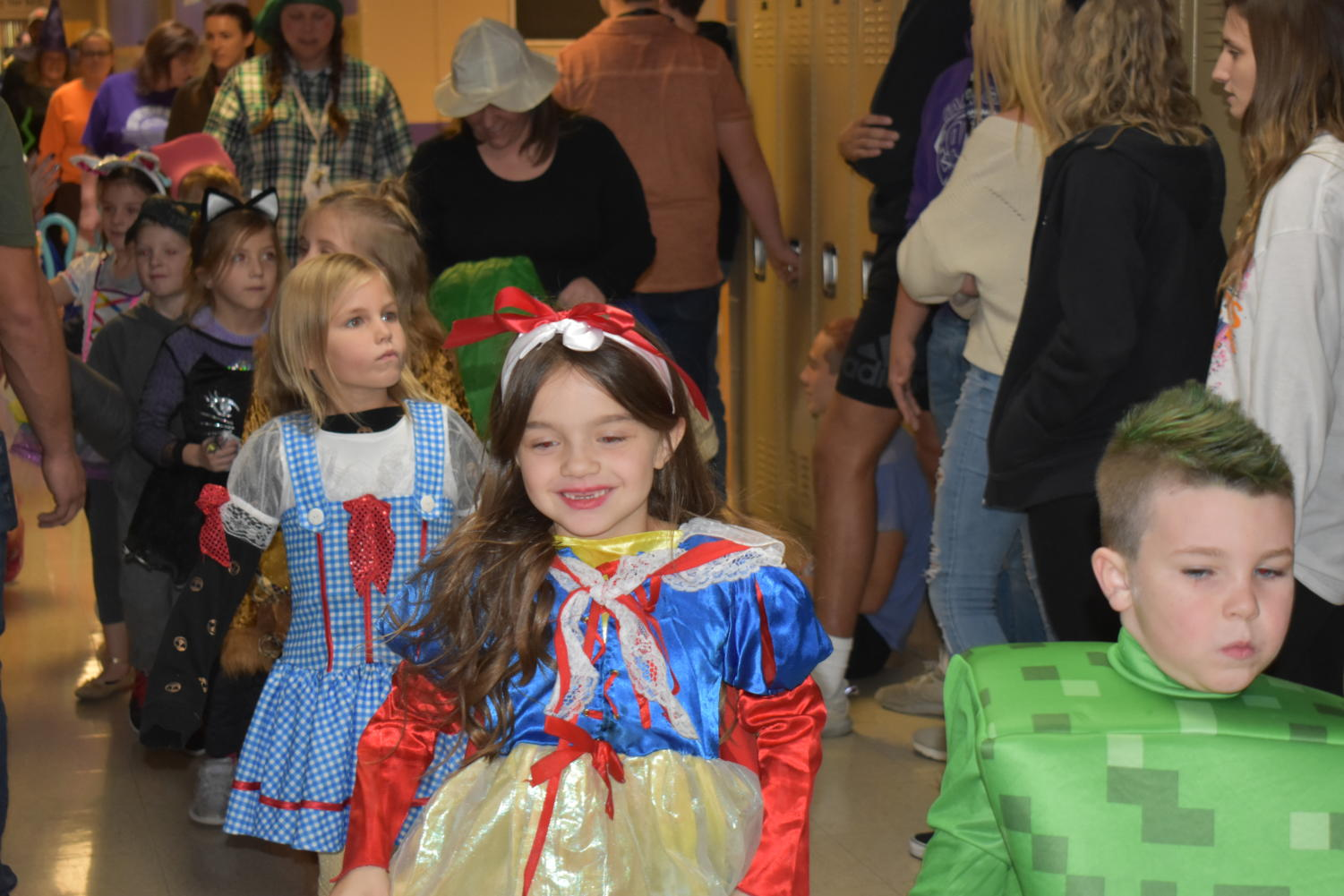 The elementary students showing their Halloween joy, through the High School