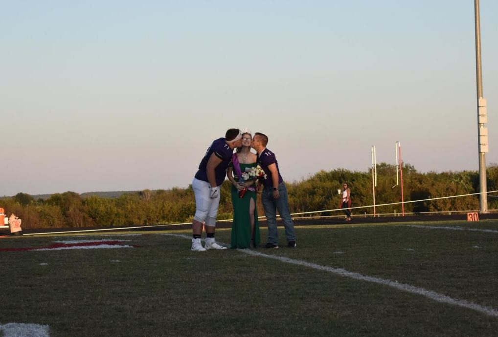 Homecoming queen, Heather Mcdougal walked by football players, Cody Jeter, and Gaven Peterie