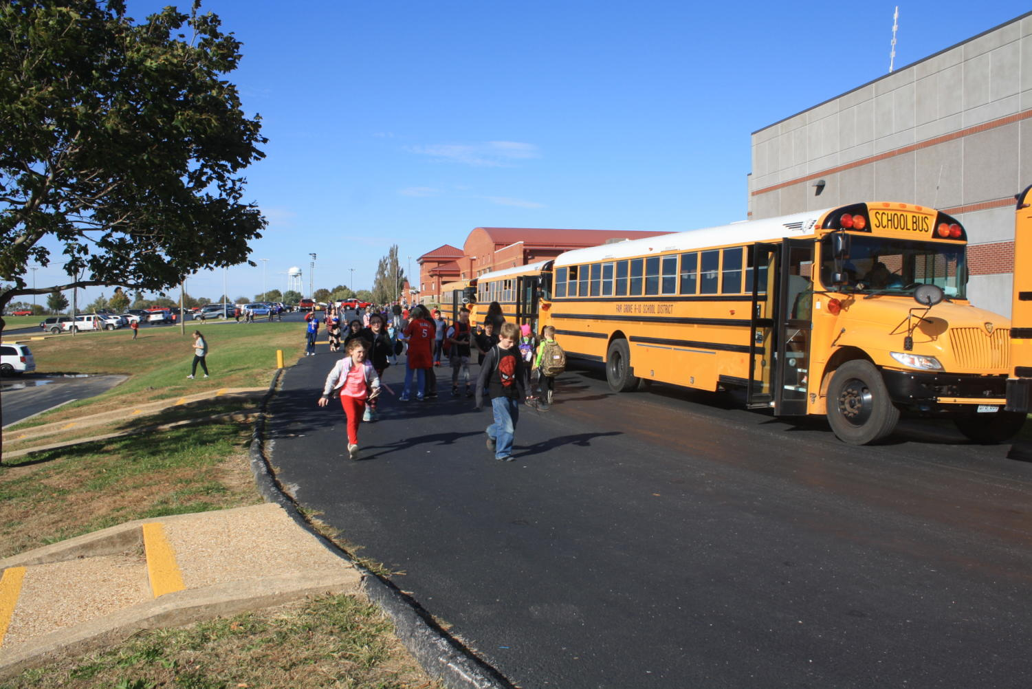 Students walking to the bus after school ready to thank their bus drivers