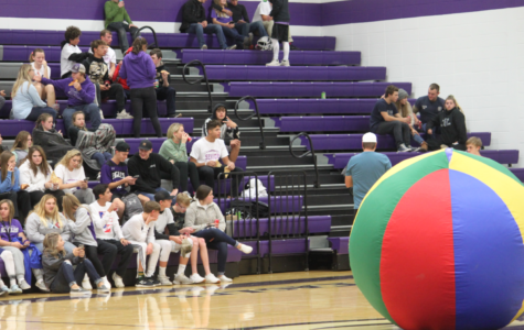 Students watching the Big Ball of Death, ready to play.