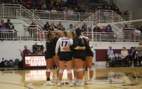 Fair Groves Volleyball team getting ready to play