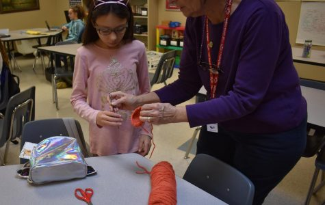 Ms. Meals helping students during crotchet club