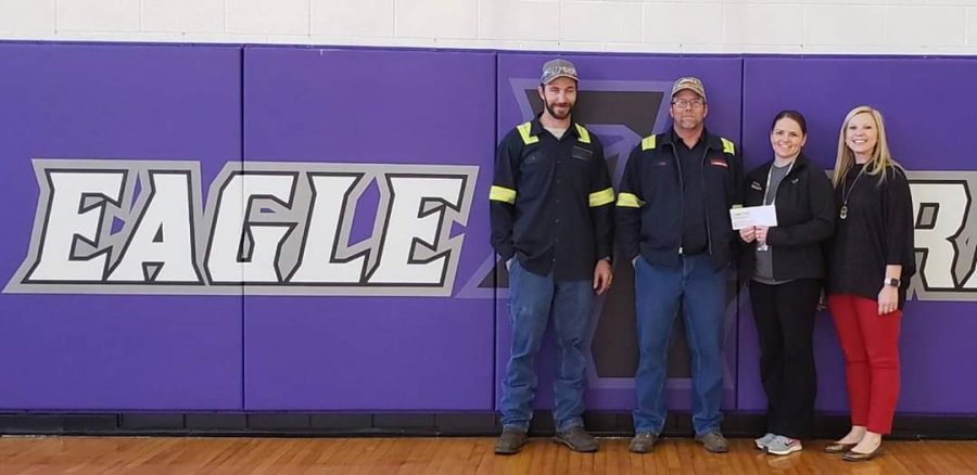 Jeff Skinner, Joe Monday, Ashley Monday, and FG elementary principal, Charity Hollan