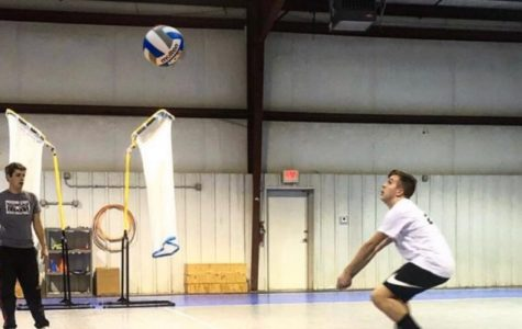 Cooper Zumwalt practicing for his out of school volleyball