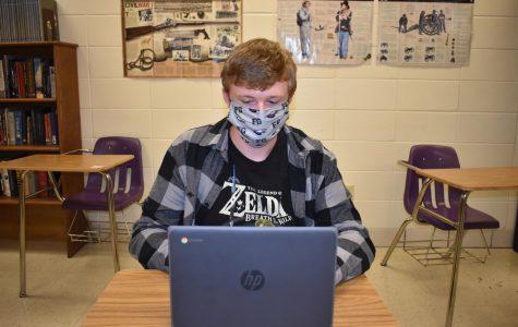 Jacob Smith (12) works on his classwork using new chromebook.