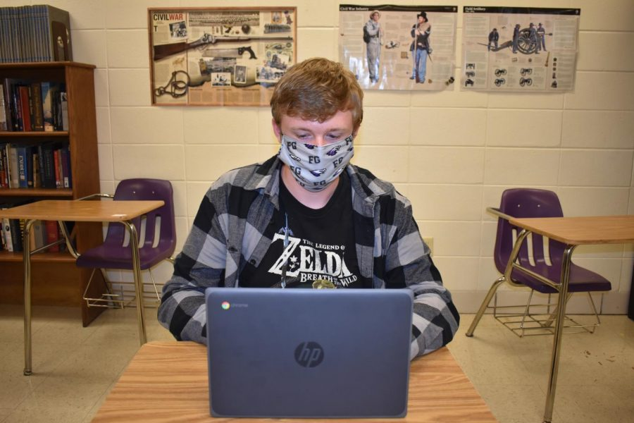 Jacob Smith (12) works on his classwork using new chromebook.