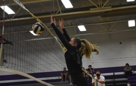 Hannah Maxwell (9) jumps for a ball in a home game against Buffalo.