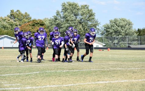 Middle School Football players preparing for their game against Forsyth