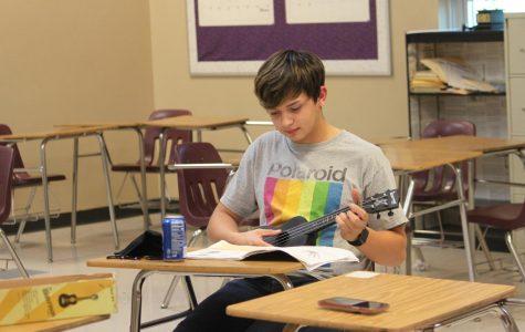 Easton Beltz, junior, learning how to play the ukulele