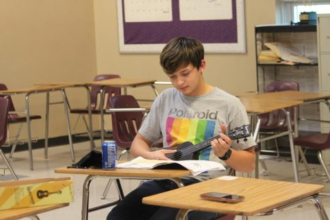 Easton Beltz, junior, learning how to play the ukulele