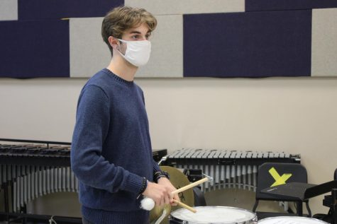 Mitch Van Cleave practicing music on the concert snare drum.
