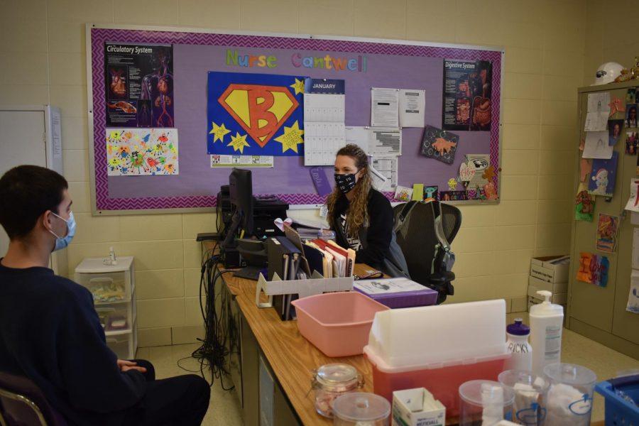 Nurse Brandy Cantwell talking with student Devon Miller (11)