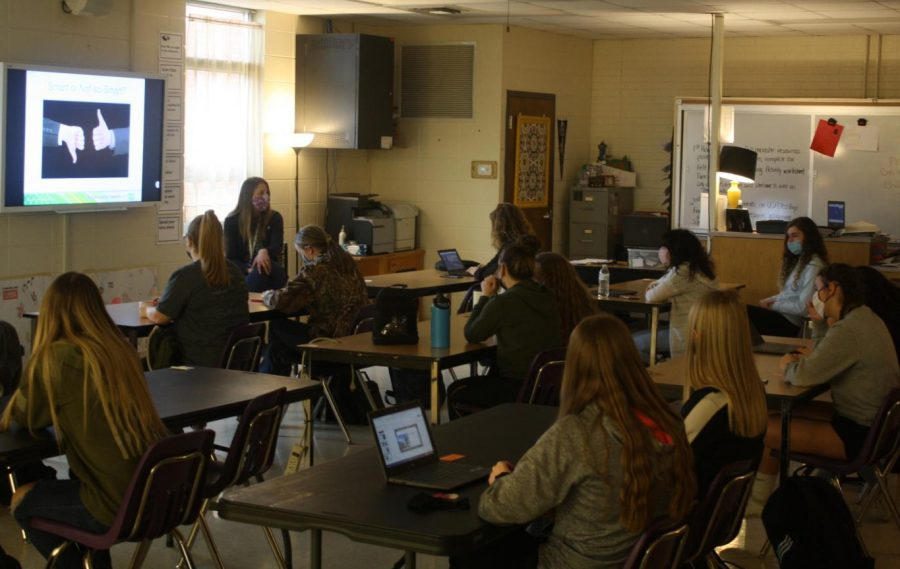 Darci Friberg teaching her Child Development class.