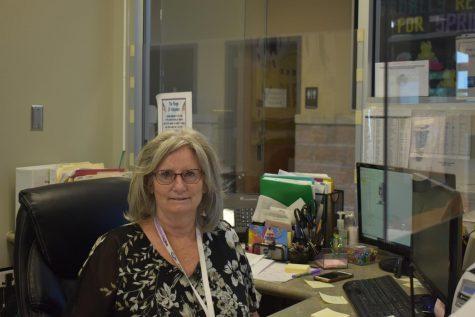 Jill Dieke working at her desk in the Middle School office.