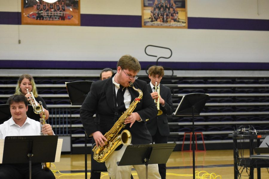 Junior band member, Elijah Daugherty, playing the tenor saxophone.