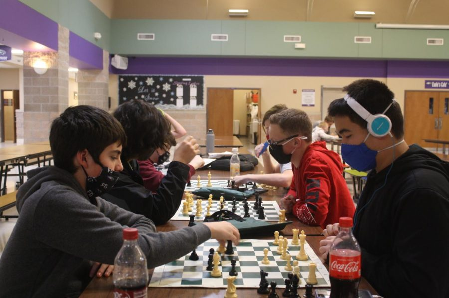 Students+strategizing+in+chess+club.