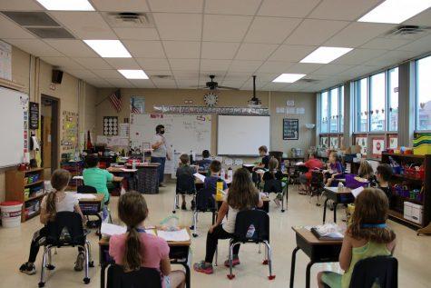 Mrs. Strader teaching her third grade class.