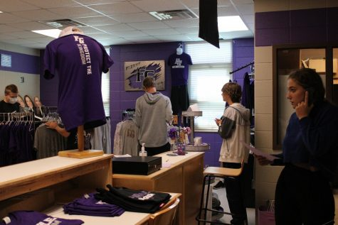 Fair Grove High School students helping to set up the school store: Flight Gear.