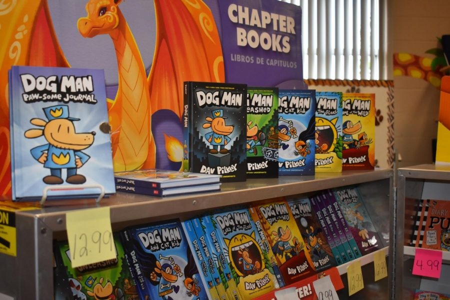 Dog Man books, by Dav Pilkey, displayed in the Elementary Book Fair.