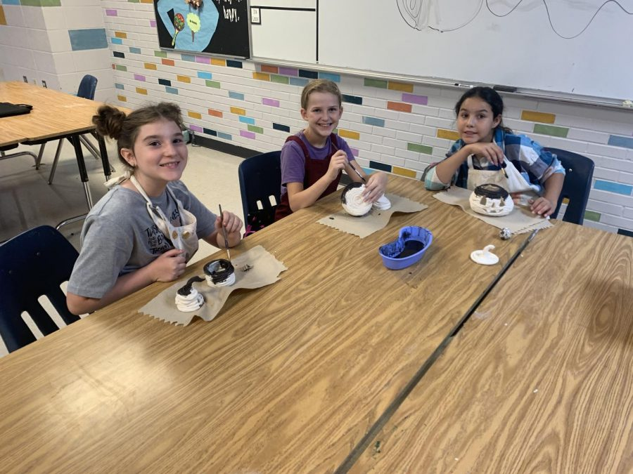 Middle School Art Club attendees Adley McMillian (5), Sam McCarthy (5), and Presley Mauldin (5) (Left to Right), create clay pumpkins for a project on 10/14.